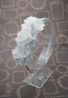 A personal favorite from my Etsy shop https://www.etsy.com/listing/208796301/white-flowered-headband-satin-mesh