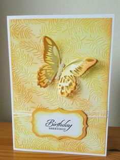 handmade birthday card ... monochromatic yellow ... embossing folder fir branch texture enhanced with sponged Distress Oxide Ink ... Tim Holtz die cut and layered  butterfly ...