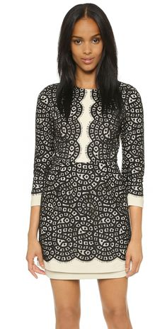 BCBGMAXAZRIA Elyssa Dress. A contrast shell accentuates the patterned lace overlay on this formfitting BCBGMAXAZRIA dress. 3/4 sleeves. Hidden back zip. Lined.