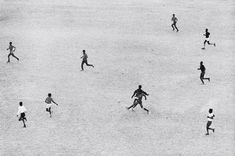 Marc Riboud, Oil workers playing soccer in the desert, Saudi Arabia, 1974