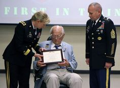 Maj. Gen. Leslie Purser, commander, 108th Training Command (IET), along with Command Sgt. Maj. Rocci DeRezza, 108th Training Command (IET) Command Sgt. Maj., presents 92 year old Paul R. Hallman Sr., World War II Army-Air Force veteran and former P.O.W. his four awards in a ceremony in his honor at the 108th Training Command (IET) Headquarters in Charlotte, NC.