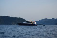Motor yacht charter Arzu's Desire in the distance, during a Marmaris sunset.