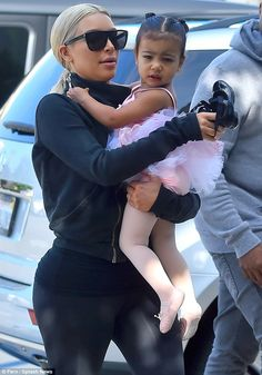 No couture here: Kim was uncharacteristically dressed down in a zip-up jacket and Nike leg...