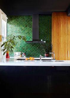 Bring life to your kitchen with a splash of colour like this green tile backsplash. #backsplash