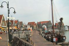 """Volendam, Holland ~ """"Originally, Volendam was the location of the harbor of the nearby Edam, which was situated at the mouth of the river IJ. In 1357, the inhabitants of Edam dug a shorter canal to the Zuiderzee with its own separate harbor. This removed the need for the original harbor, which was then dammed and used for land reclamation. Farmers and local fishermen settled there, forming the new community of Vollendam, which literally meant something like 'Filled dam.'"""""""