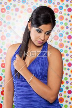 attractive young female posing for the camera. - image of a attractive young Indian female posing for the camera, Model: Sabrina Remkissoon