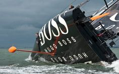 Alex Thomson performing the 'keel walk', a stunt infamous in sailing thanks to this photograph. ~ his 8-ton carbon fibre yacht, Hugo Boss