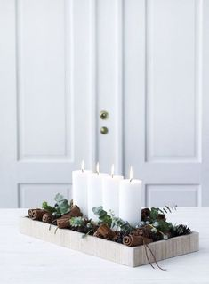 christmas inspiration A Minimalist Christmas: 12 Understated (But Still Gorgeous) Decorating Ideas Minimalist/Maximalist Christmas Candle Decorations, Scandinavian Christmas Decorations, Advent Candles, Christmas Candles, Winter Decorations, Modern Christmas Decor, Table Decorations, Christmas Design, Christmas Decorations For Apartment