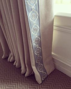 Simple and oh so elegant curtains which are slightly overlong.  With a braid added to the leading edge. By Sinclairs Soft Furnishings for Lally Walford Interiors