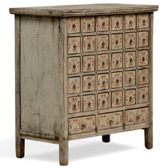 Originally made and used in China's Shanxi province over 150 years ago, this medicine chest in cream lacquer still has its original finish, including the drawer labels and drawer handles. Once used by an apothecary to hold the herbs and remedies used in Chinese medicine.