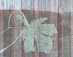 This weaving technique is called transparency and renders a lacy, translucent fabric with areas of opaque inlay designs
