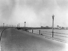 A 1937 view of Rainbow Pier with one of Long Beach's seaside roller coasters in the distance. Courtesy of the Photo Collection - Los Angeles...