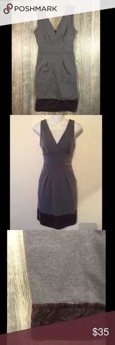 BCBGMaxazria gray and velvet hem dress BCBGMaxazria gray and velvet hem dress. Zipper in the back. Velvet detail on hem and zipper. Pockets. Some light wear thru out dress from wearing. 37 inches long. Polyester rayon 5% spandex, contrast is silk and rayon. Dry clean. Tag reads size 0 BCBGMaxAzria Dresses Midi