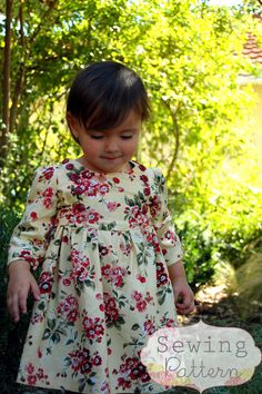 This sweet little dress pattern has 3/4 length sleeves, ties in the back and has an adorable button lined bodice. Pattern pieces are included