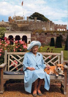 Her Majesty Queen Elizabeth the Queen Mother with one of her Favourite Corgis in the Gardens at Walmer Castle, July 2001