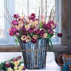 Spring bouquet of tulips and a pussy willow covered vase on my happy room in early Spring! #goodhousekeeping and #happyroom