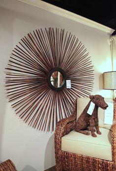 Oversized wooden sunburst by Palecek Furniture & Accessories.