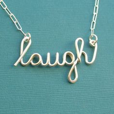 laugh necklace (sterling silver wire word necklace). $38.00, via Etsy.