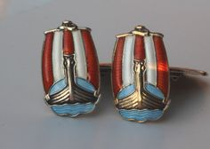 Cufflinks, gilded sterling silver and enamel. All four buttons have the same motive, a Viking ship against a background of red and white stripes.