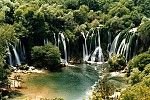 Kravice is a waterfall on the Trebižat River in Bosnia and Herzegovina. It is ten kilometers south of Ljubuški and forty kilometers south of Mostar. Its height is between 25 meters and the radius of the lake in the base of the waterfall is 120 meters.Kravice is a popular swimming and picnic area and, during the summer, it is frequently visited by tourists from Mostar, Medjugorje and Dubrovnik.The Kravice Falls area also has a little cafe, a rope swing, a picnic area, and a place to camp.The…