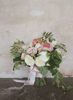 Loose stems and a pink satin ribbon lend a rustic, just-gathered touch to the flowers. Colleen Riley Photography. Fleurs du Soleil.