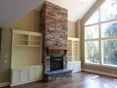fireplace, new construction, cultured stone, raised hearth, built-ins around fireplace, living room,hardwoods www.brownbrosmasonry.net