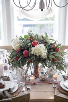 Classic Christmas Tablescape - Ella Claire- Classic Christmas Tablescape – Ella Claire A simple and beautiful Christmas tablescape with classic traditional red, green gingerbread, pomegranates and berries in the warm glow of candlelight. Centerpiece Christmas, Christmas Flower Arrangements, Christmas Flowers, Christmas Table Settings, Christmas Tablescapes, Christmas Table Decorations, Noel Christmas, Christmas Colors, Floral Arrangements