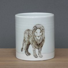 SKT ceramices: lion tumbler