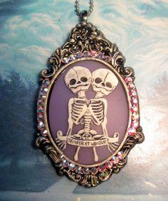 Siamese twin freak show cameo pastel goth lolita purple Swarovski crystal. $25.00, via Etsy.