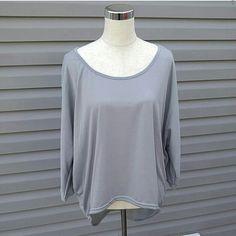 Gray Hi-Lo Top Gray 3/4 Sleeve Hi-Lo Top   This is NWOT Retail. Price Firm Unless Bundled Tops