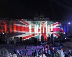 Proud to be British: A Union Flag lights of the front of the Palace