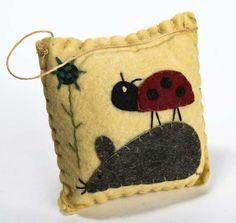 ladybug on a mouse pillow