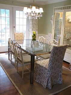 nice use of bamboo chairs and ikea slipcovered chairs (with custom slipcovers)