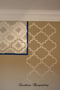 Stencil pattern idea with glossy paint same color as wall. I like this for an accent wall, maybe in the kitchen or dining room.