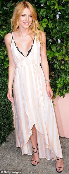 Summer style: Made of pale pink and white-striped fabric, Bella's dress was lightweight an...