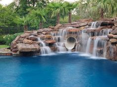 | Houston pools with rock waterfall fountain