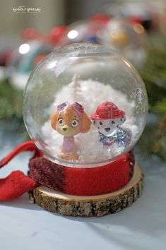 """Do you have a kid who walks around the house singing the """"Paw Patrol"""" theme song? Make these cheap and cute Paw Patrol holiday ornaments with them. Paw Patrol Christmas Ornaments, Diy Christmas Ornaments, Holiday Crafts, Kids Christmas, Holiday Ideas, Holiday Inflatables, Dollar Store Halloween, Globe Ornament, Unicorn Crafts"""