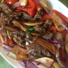 How To make  LOMO SALTADO  - A Peruvian Beef Stir Fry With Soy Sauce and French Fries