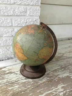 Prop reference for globe - retro look and we would need to change the world map from 2016 to a future earth with little land and more water Love Vintage, Vintage Globe, Vintage Maps, Vintage Antiques, World Travel Decor, World Globe Map, Old Globe, Show Me The Way, Old Maps