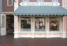 The happy, mouthwatering perfume of vanilla and waffle cones wafting outside Main Street's Candy Palace.