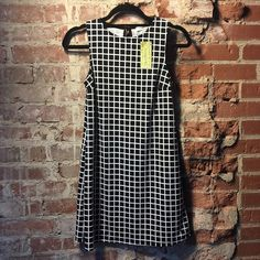 🔱 LAST CHANCE ‼️ Grid Pattern Dress 🎉 Lowest price unless bundled! 🎉 Grid design, sleeveless, single layer, stretch, keyhole back. 💋 Happy Poshing! (x trade) Ginger G Dresses
