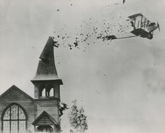 A Curtiss Jenny hitting a church tower. Photo must probably taken during the…
