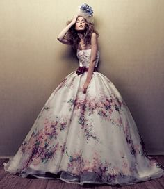 The A-line wedding dresses are ideal for pear shape of bride who want to minimize the curve of the hips.