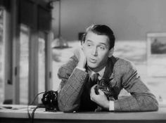 """Jimmy Stewart plays with a kitten in the 1947 Film """"Magic Town"""" :)"""