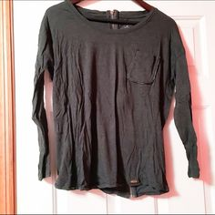 CALVIN KLEIN SHIRT Great condition!! Hardly worn. The shirt is charcoal grey with a tee shirt pocket. The pocket is outlined with black leather. It is a long sleeve shirt with a gold zipper going down the back. Calvin Klein Tops Tees - Long Sleeve