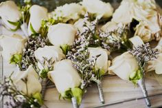 White rose and lavender boutonnieres were the perfect pick for these @Mandy Dewey Seasons Hotel San Francisco groomsmen.