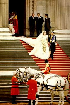 The newlyweds the Prince & Princess of Wales leaving St. Paul's Cathedral to their horse-drawn carriage . They will then proceed to Buckingham Palace to their luncheon reception given by HRH Queen Elizabeth II. *** <3 this picture...reminds me of Cinderella & her prince.  The fairytale becomes reality here for the beautiful Princess Diana & her Prince Charles.