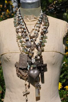 A compilation of assemblage necklaces by Hallowed Adornments
