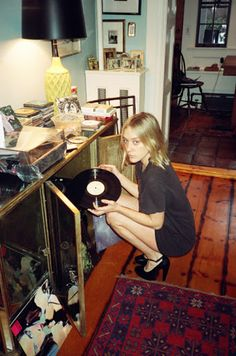 Play records in T-shirts & heels.