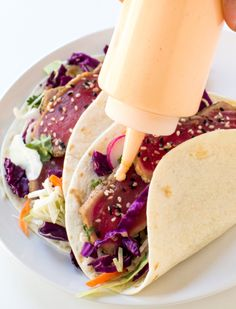 Seared Ahi Tuna Tacos loaded with cabbage, cilantro, radishes and topped with a spicy sriracha mayo. Fish Recipes, Seafood Recipes, Mexican Food Recipes, Cooking Recipes, Healthy Recipes, Ahi Tuna Steak Recipe, Tuna Steaks, Ahi Fish Tacos Recipe, Seared Tuna Tacos Recipe